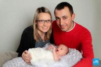 Shooting d'un nouveau né avec ses parents