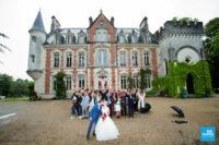 photo de groupe au château devant un château